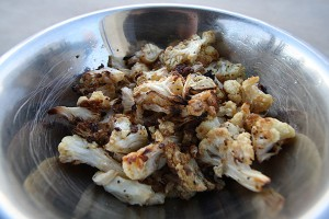 The key to roasted cauliflower is in some salt, some pepper, some olive oil and an uncrowded baking sheet.